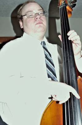 Ricky Elrod standing with an upright bass